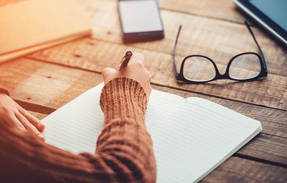 Woman Writing a Weight Loss Plan