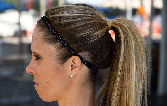 The classic ponytail is a super simple but effective way to get hair out of your eyes and off your neck. This works for most hair types and lengths,