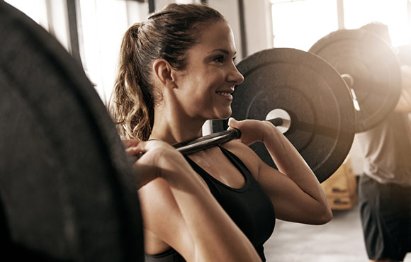 Top 10 Reasons Women Should Hit the Weights