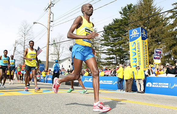 Wesley Korir, of Kenya, warms up prior to the start of the 117th running of the Boston Marathon, in Hopkinton, Mass. Korir had recently been elected to Parliament in his native Kenya. (AP Photo/Stew Milne, File)