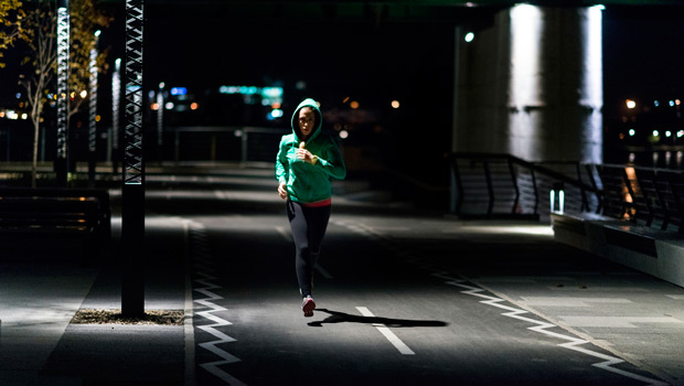 A woman running alone.