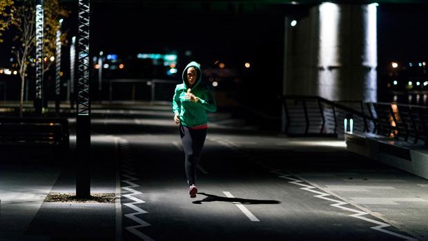 A woman running alone.