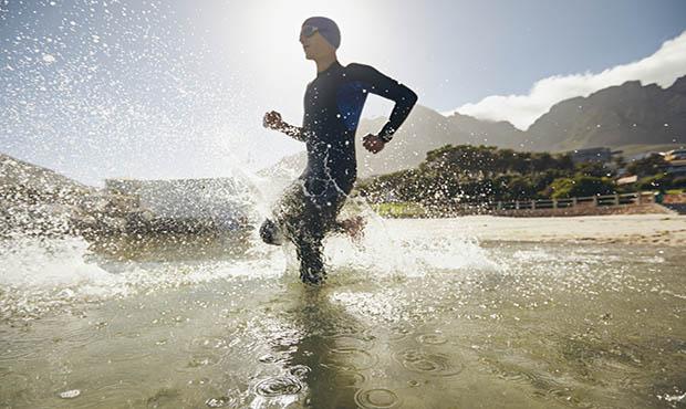 Man running in water.