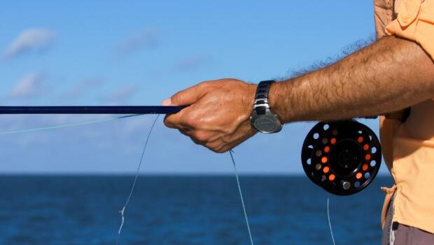 Fly Rod in Man's Hands