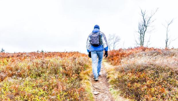 Man Walking Uphill