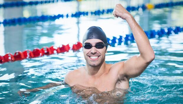 Swimmer Raising Arm in Pool