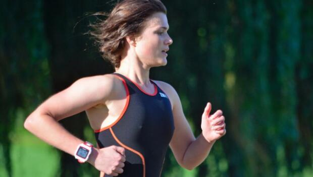 Triathlete Running in Black Skinsuit