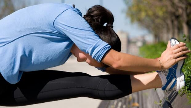 Woman Stretching Hamstring