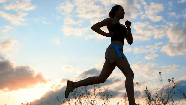 Silhouette of Woman Runner