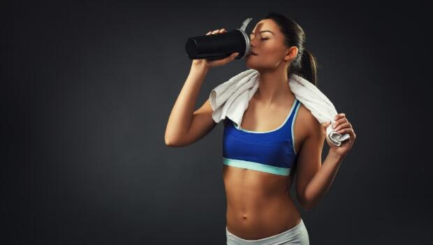 woman drinking proteins