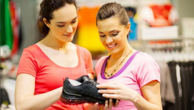 Woman Choosing Running Shoe