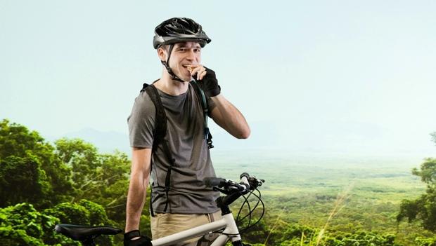 Biker Eating Protein Bar
