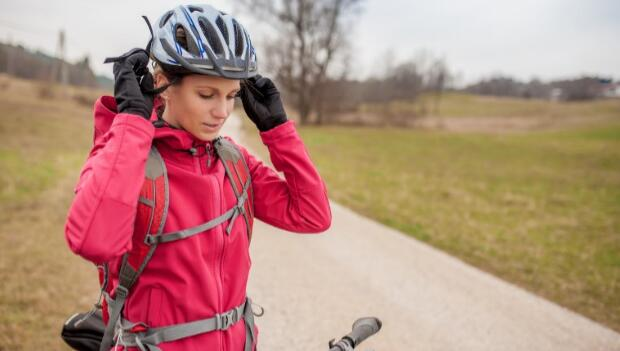 Female Biker Wearing Helmet