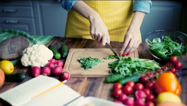 Woman Cutting Fresh Vegetables