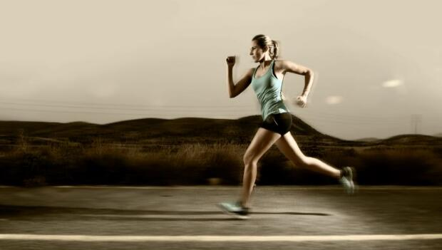 Woman Running on Asphalt Road