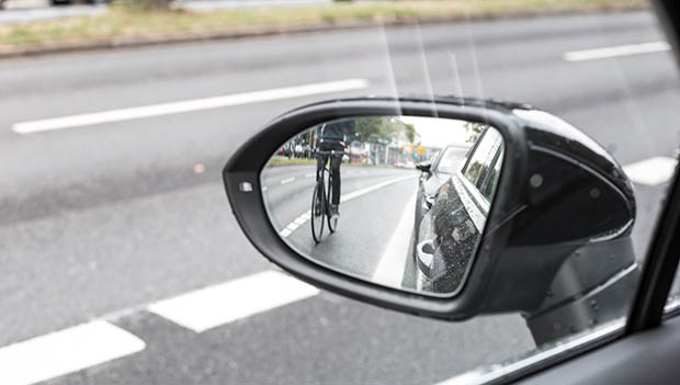 cyclist in rearview mirror