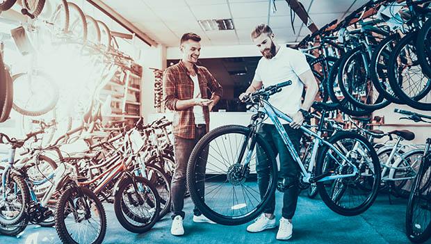 two men in a bike shop