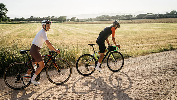 two cyclists on gravel