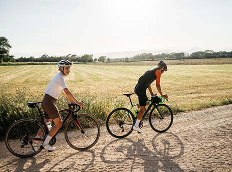 Two+cyclists+on+gravel front