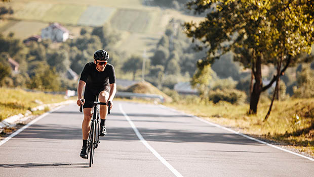 man cycling with glasses