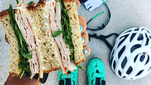 cyclist with sandwich