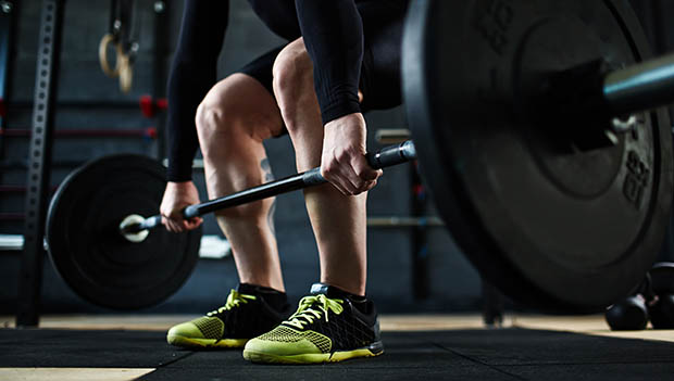 man using a barbell