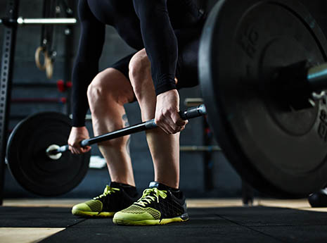 Man+using+a+barbell front
