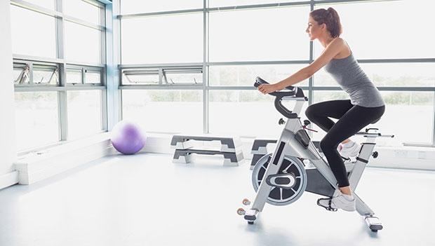 woman-riding-a-stationary-bike