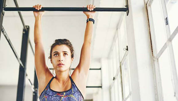 woman on a pull-up bar