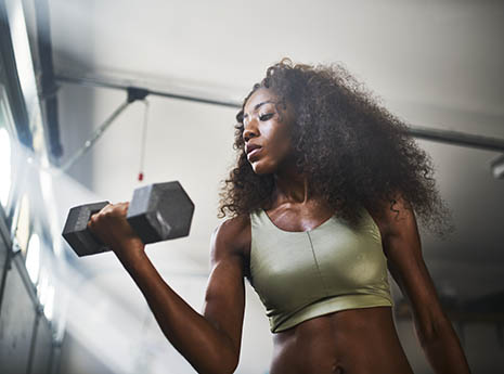 Woman+lifting+weights front
