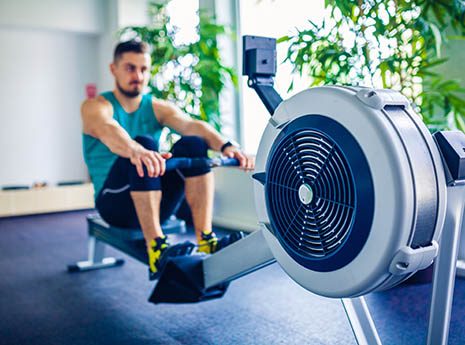 Man+on+a+rowing+machine front