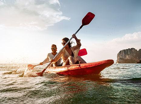 Two people kayaking front