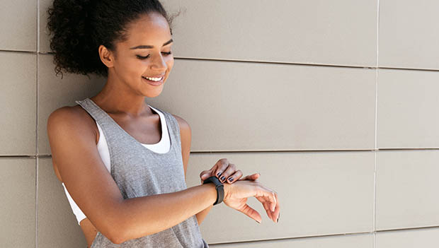 woman looking at her fitness tracker