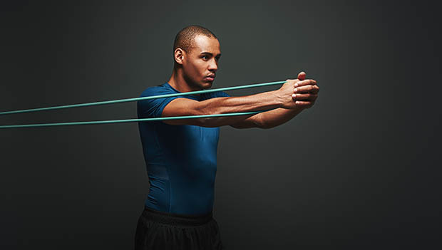 man using a resistance band