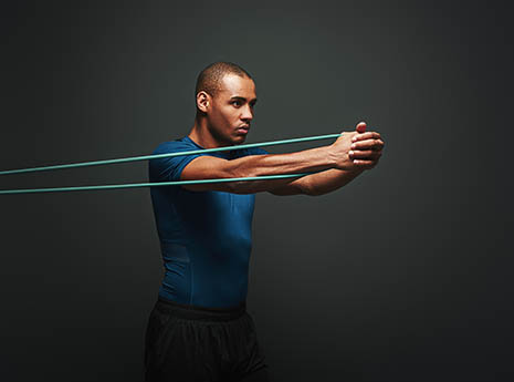 Man+using+a+resistance+band front