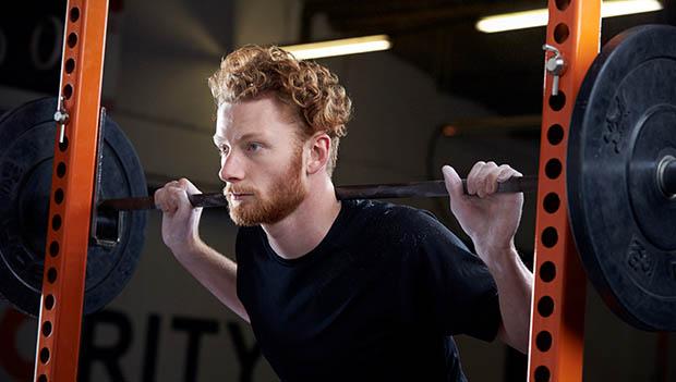 man using a squat rack