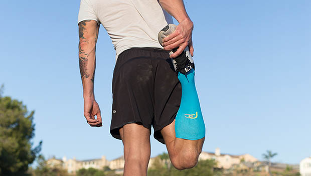man stretching in compression socks