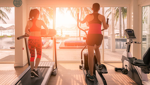 women working out on cardio machines