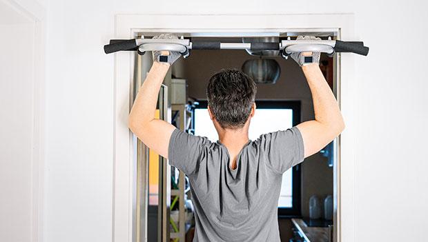 man-using-a-pull-up-bar