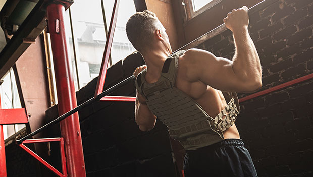 man-doing-pull-ups-with-a-weighted-vest