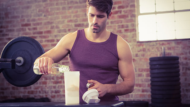 man-pouring-water-into-a-blender-bottle