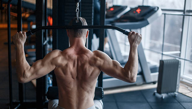 man doing a lat pull down