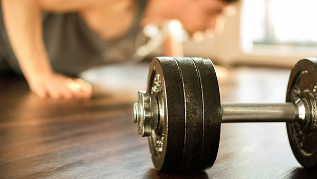 dumbbell with person working out in the background