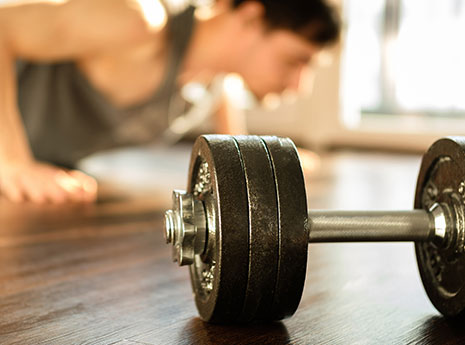 Dumbbell with person working out in the background front