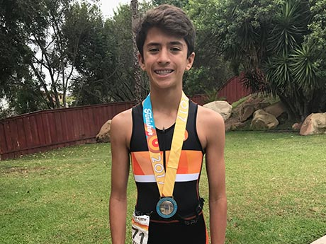 How This Kid Triathlete Fits in Homework, Training—and Feeding the Homeless