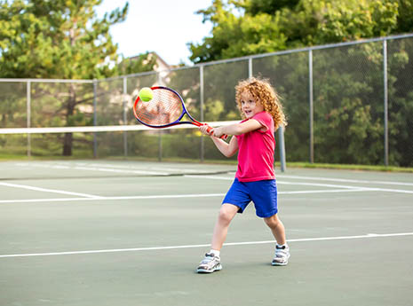 Kid+playing+tennis front