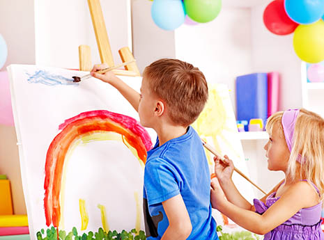 Two+kids+painting+a+rainbow front