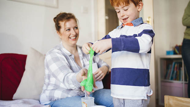 kid playing with slime