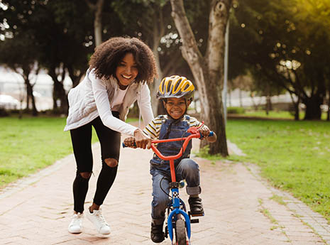 Mother+teaching+son+to+ride+a+bike front