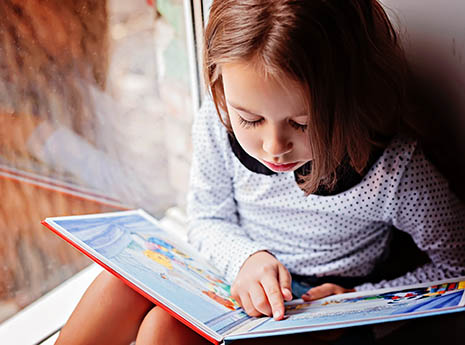 Child+reading+a+book front